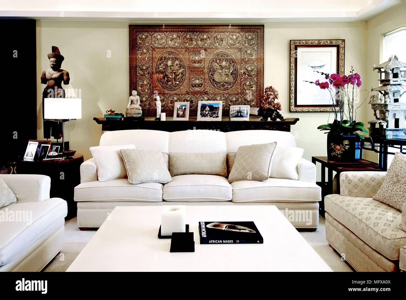 Upholstered Seating Around Coffee Table In Ethnic Style Sitting Room