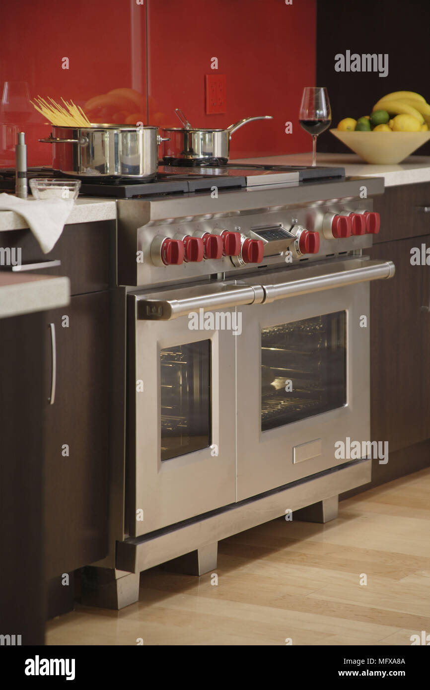 Stainless steel range oven with red knobs