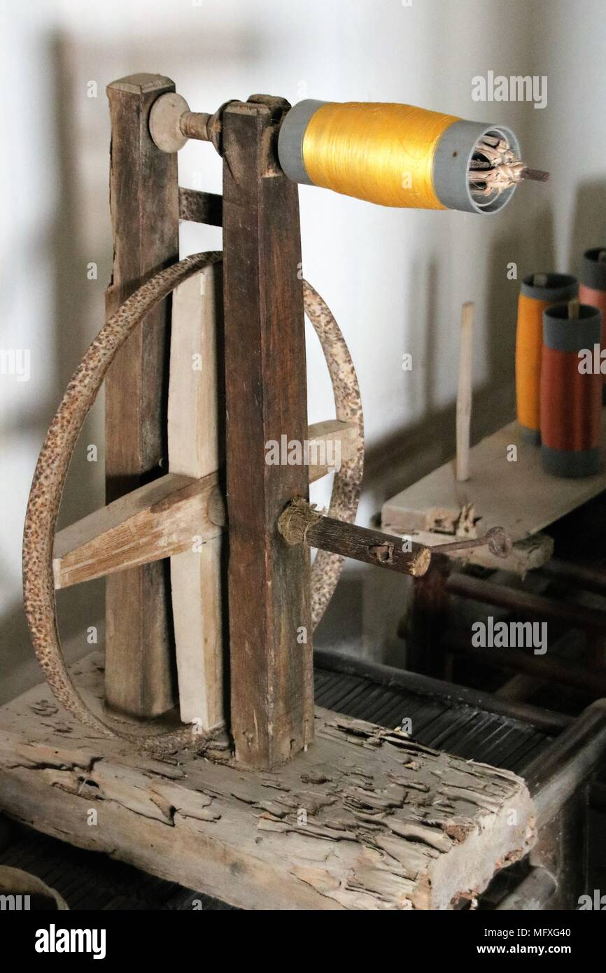 A spool of yellow thread - Stock Image
