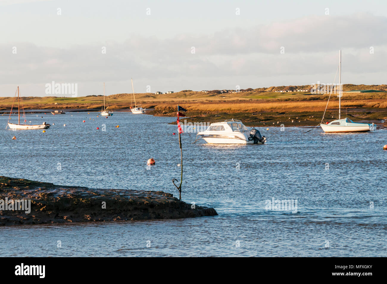 View across Mow Creek to saltmarshes from Brancaster Staithe on the North Norfolk coast. Stock Photo