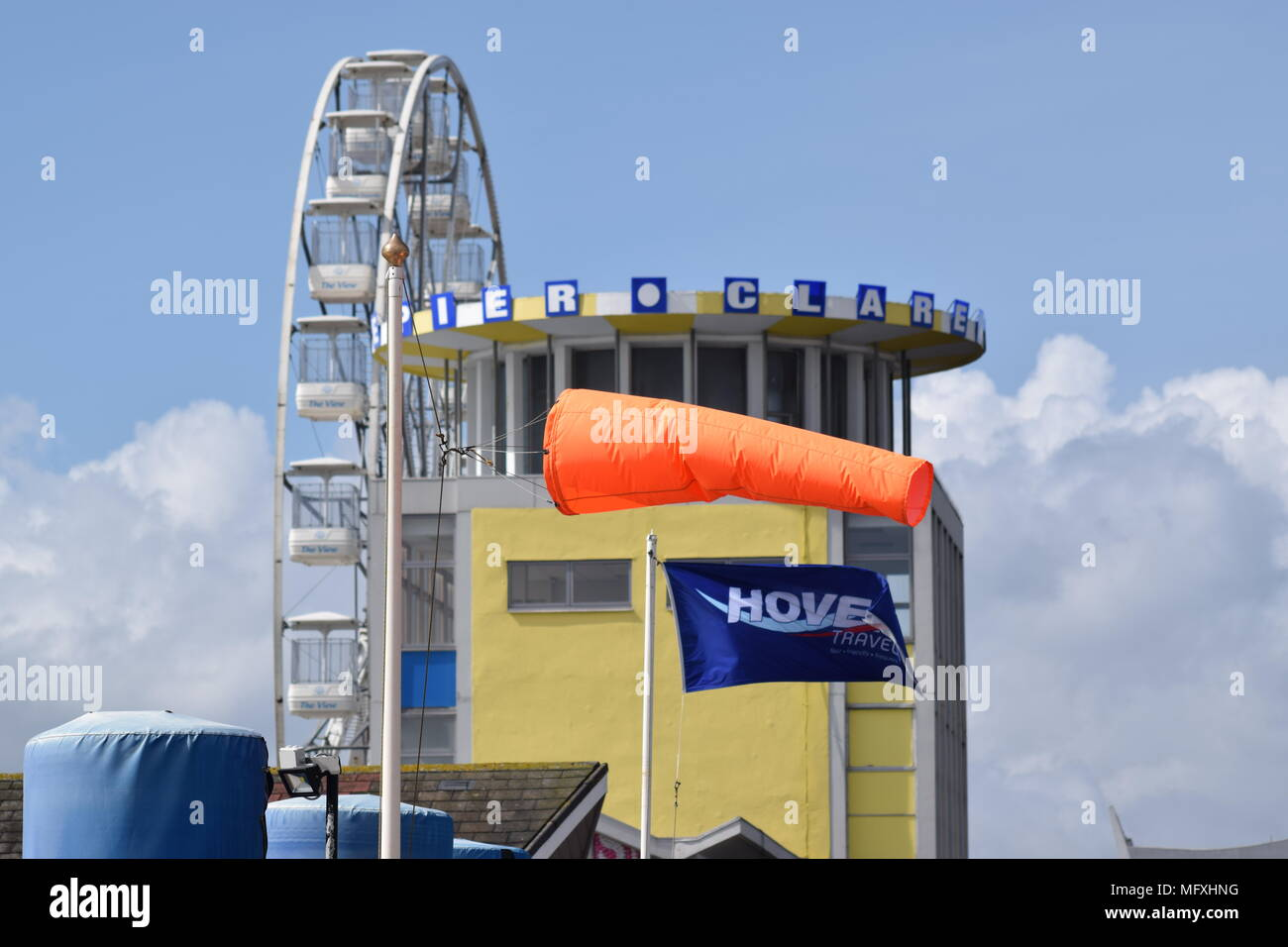 WINDY DAY: THE WINDSOCK AT SOUTHSEA HOVERPORT BESIDE CLARENCE PIER FLIES ALMOST HORIZONTALLY IN A STRONG ONSHORE BREEZE APRIL 26TH 2018 - Stock Image
