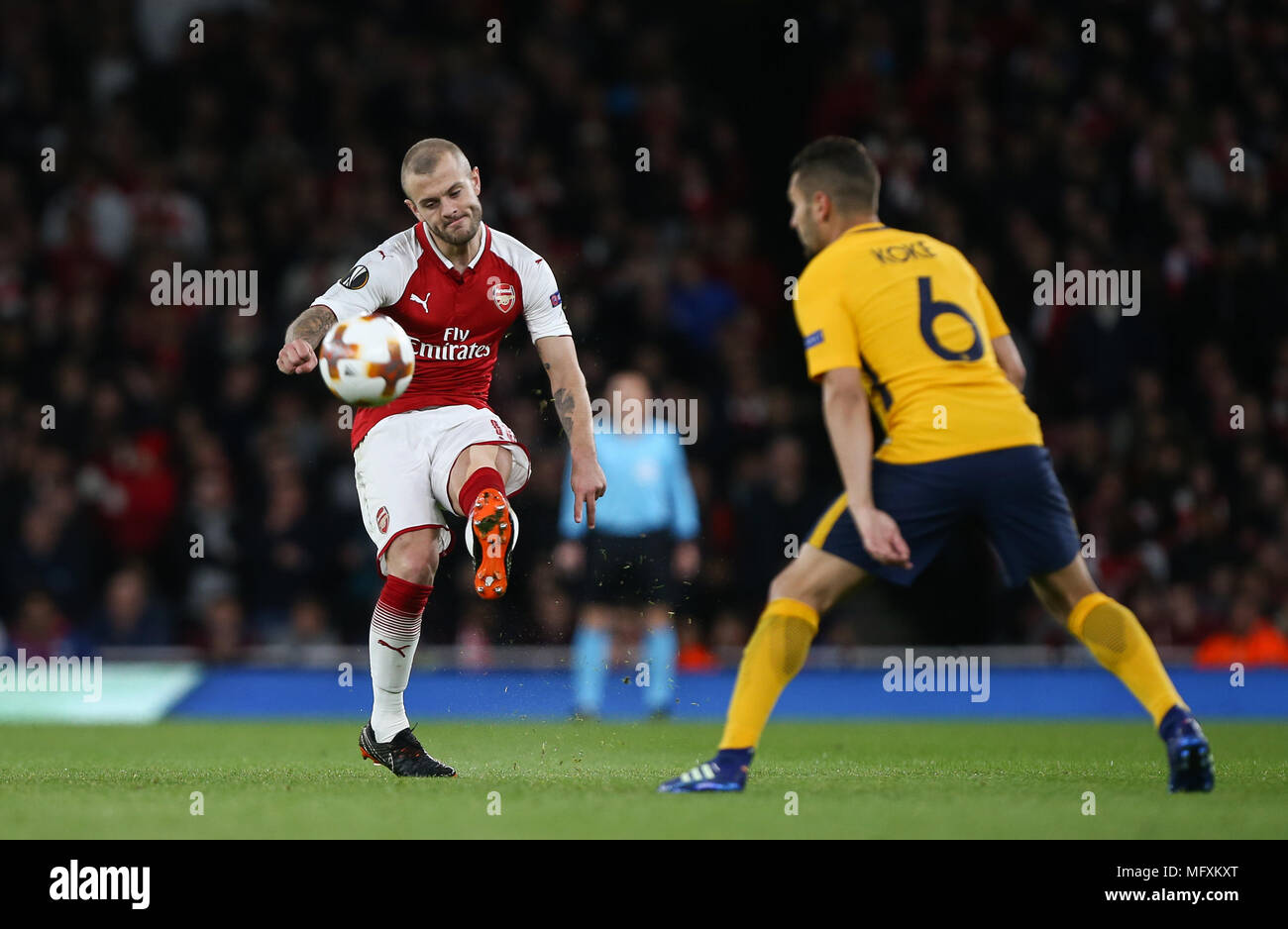 London, UK. 26th April, 2018. Jack Wilshere of Arsenal passes the ball during the UEFA Europa League Semi Final first leg match between Arsenal and Atletico Madrid at Emirates Stadium on April 26th 2018 in London, England. Credit: PHC Images/Alamy Live News - Stock Image