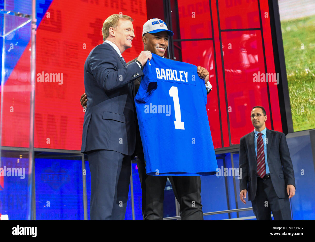 ... poses with Commissioner of the National Football League Roger Goodell  after being picked  2 overall by the New York Giants during the first round  ... 226323284
