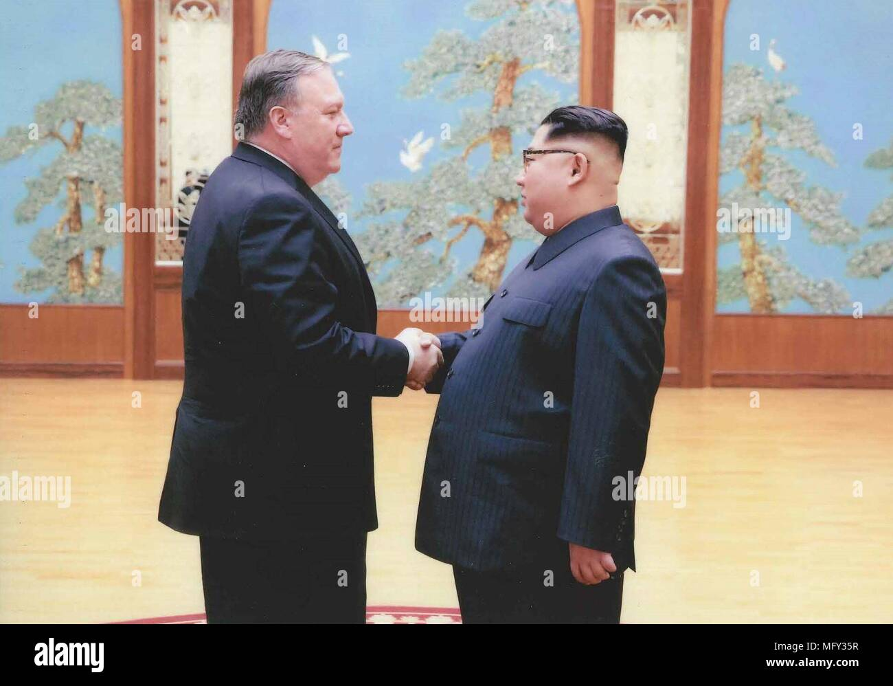 The White House released pictures April 27, 2018 showing CIA Director Mike Pompeo, left, shaking hands with North Korean leader Kim Jong Un during a secret meeting over Easter weekend in April 2018 in Pyongyang, North Korea. Pompeo was the most senior U.S. official to meet a North Korean leader since 2000. - Stock Image