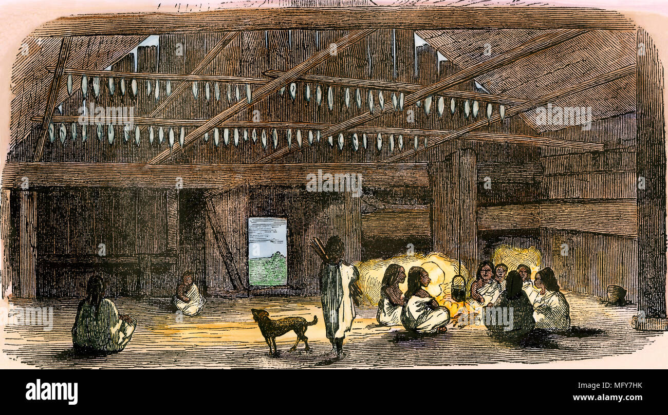 Fish drying inside a Native American home, Washington Territory, 1850s. Hand-colored woodcut - Stock Image