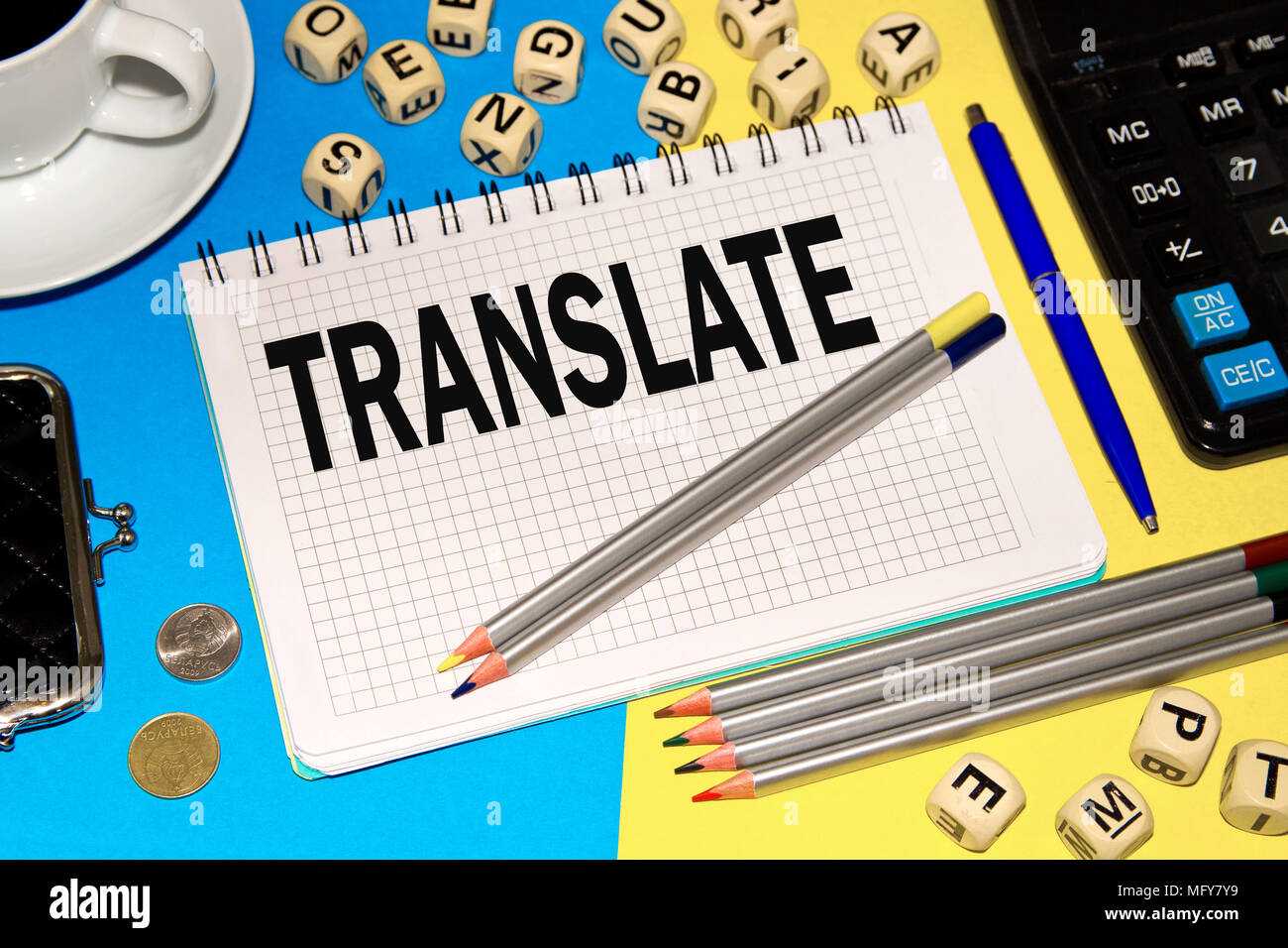 Notebook with Notes TRANSLATE with office tools and dice with letters . Concept TRANSLATE - Stock Image