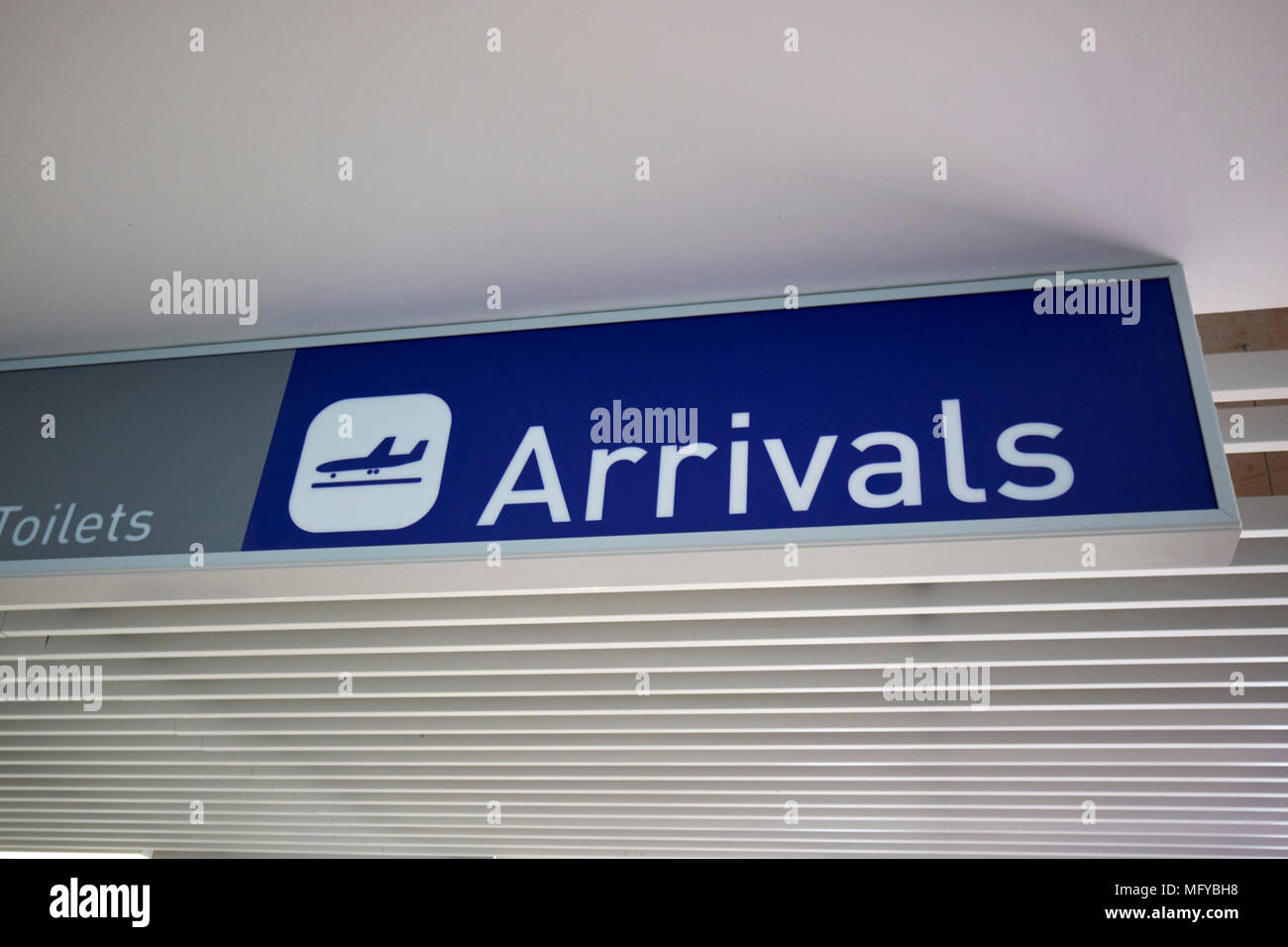 blue arrivals sign at bristol airport england uk - Stock Image