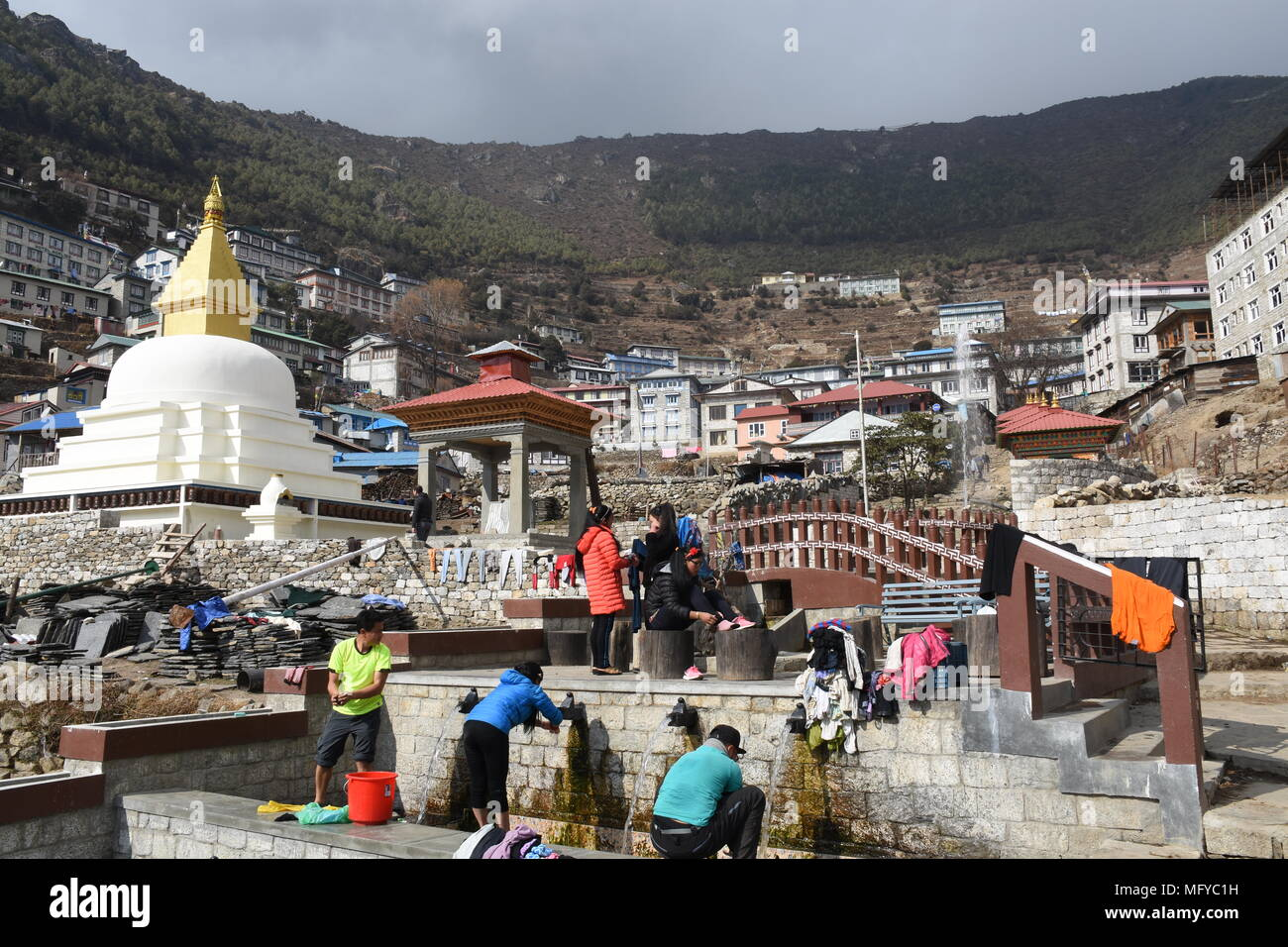 Namche Bazaar, Nepal - March 10,  2018: People washing clothes in a creek - Stock Image