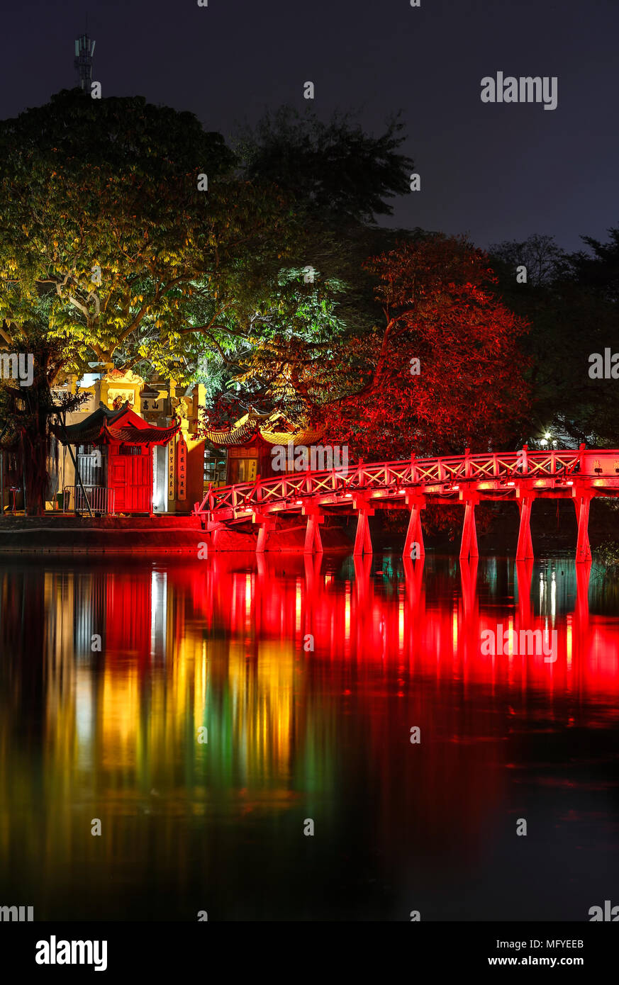 Red bridge reflecting on water, Ngoc Son Temple (Temple of the Jade Mountain), Hoan Kiem Lake, Old Quarter, Hanoi, Vietnam - Stock Image