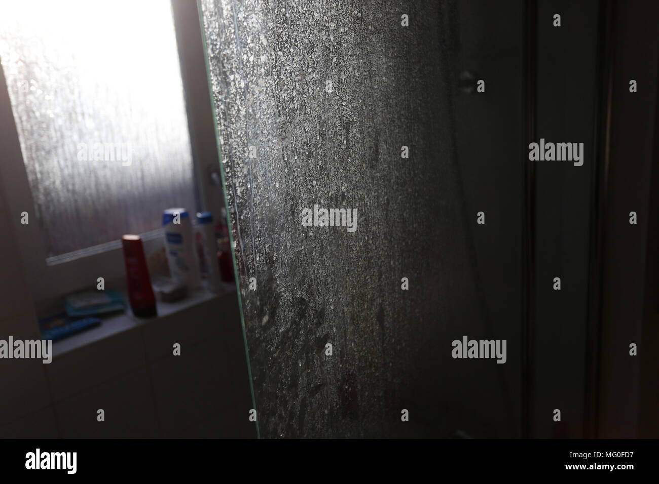 Water stains and Hard Water Spots pictured on a shower glass door in ...