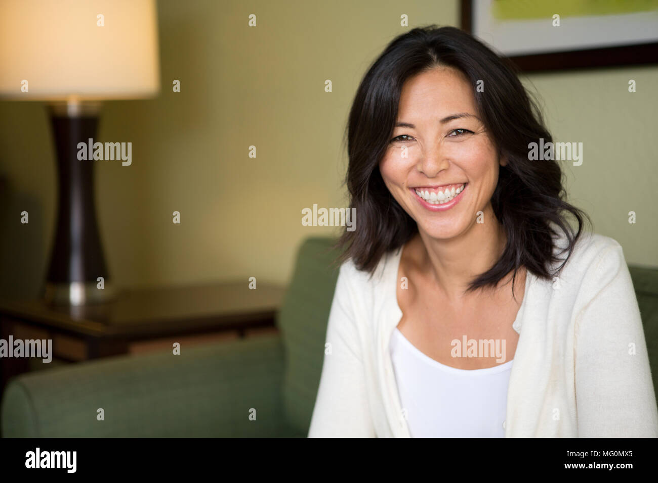 Portrait of an Asian woman smiling. Stock Photo