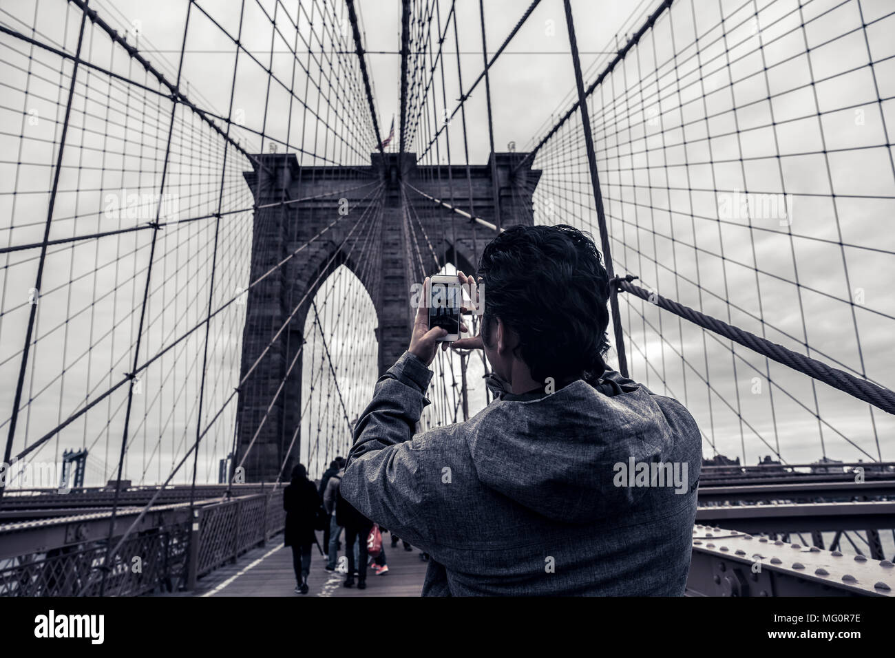 Coceptual cinematic photography tourist man taking picture with cell
