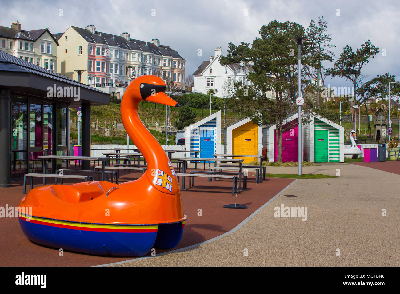 26 April 2018 A bright red swan pedalo used as an R.N.L.I. donation box at the Pickie fun park on the seafront of Bangor County Down Northern Ireland - Stock Image