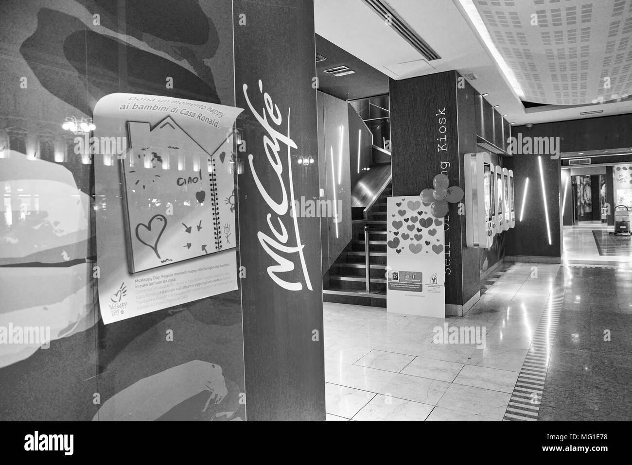 MILAN, ITALY - CIRCA NOVEMBER, 2017: McDonald's restaurant interior. McDonald's is an American hamburger and fast food restaurant chain. - Stock Image