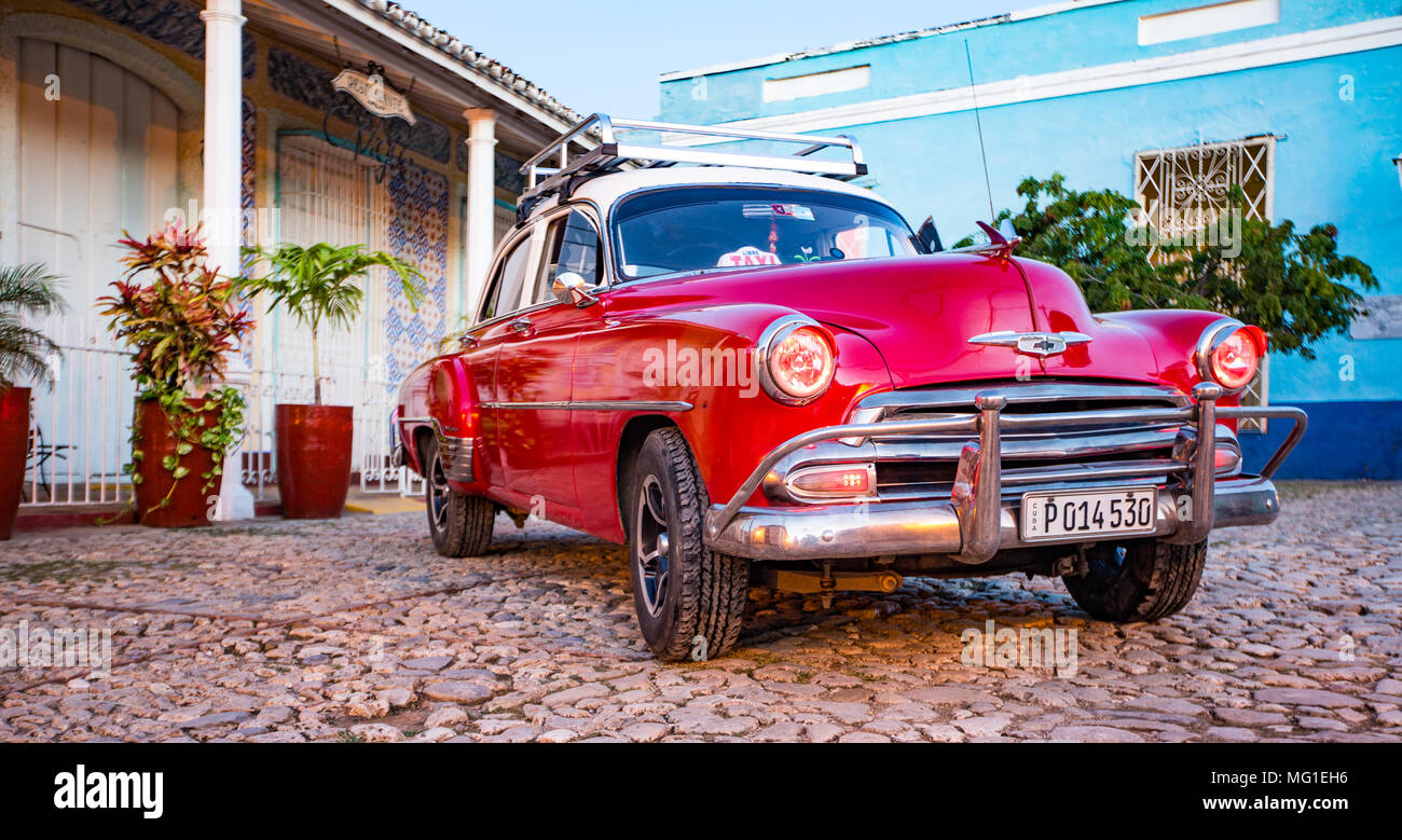 Trinidad, Cuba, Nov 28, 2017 - Red Classic 1950's Chevrolet is parked in front of a home - Stock Image