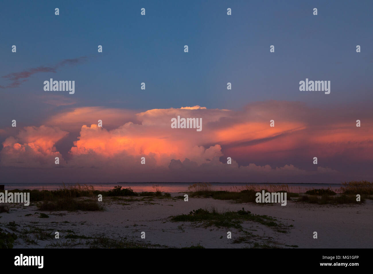 Distant thunderstorms over water during sunset, Boca Grande FL - Stock Image
