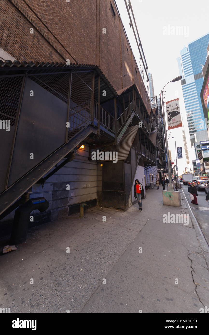 Vertical shot of long stair case on side of building, NY City - Stock Image