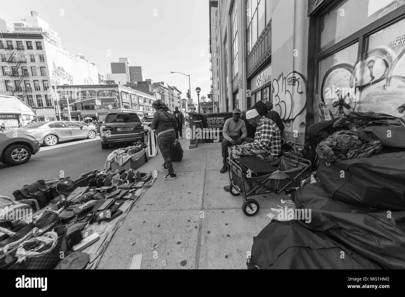 Street shot of people selling purses and watches, NYC Manhattan Stock Photo