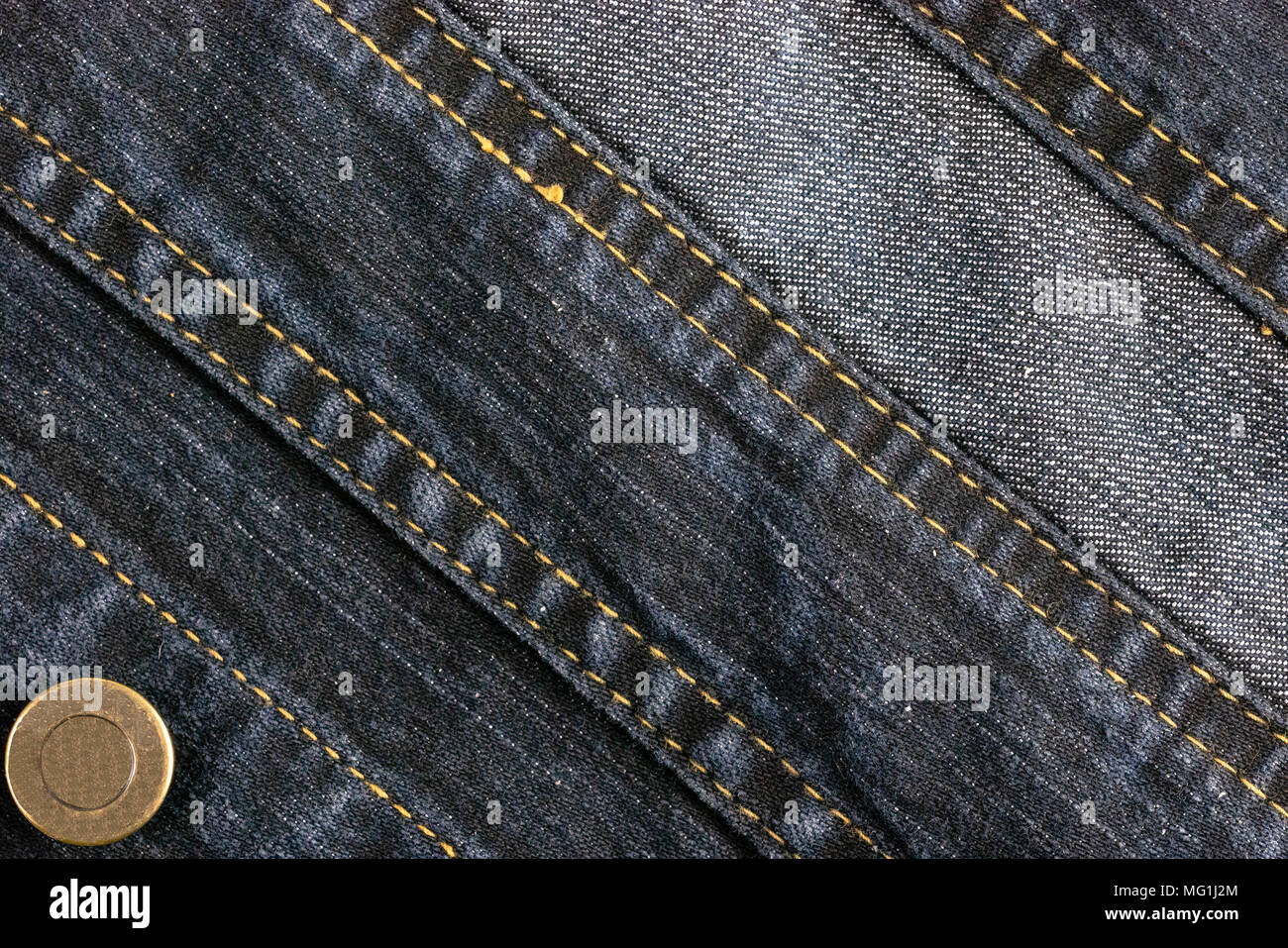 Abstract background and texture of denim jeans and buttoned - Stock Image