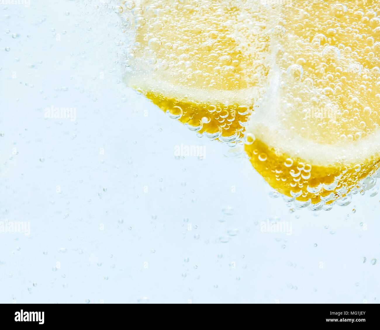 in soda, two slices of fresh juicy lemon. - Stock Image