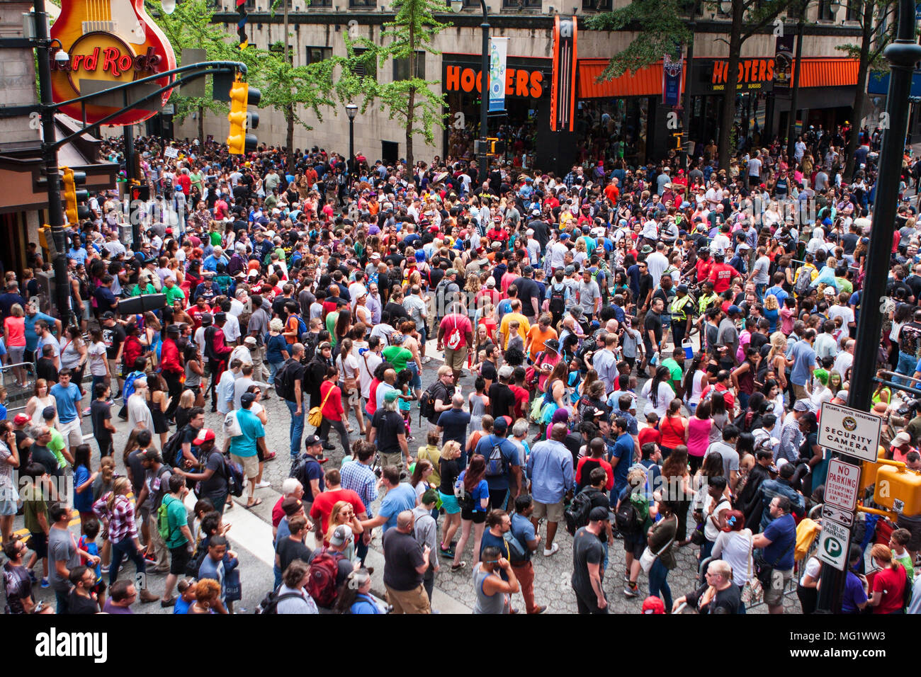 A huge crowd of spectators disperses on Peachtree Street following the conclusion of the annual Dragon Con Parade on September 3, 2016 in Atlanta, GA. - Stock Image