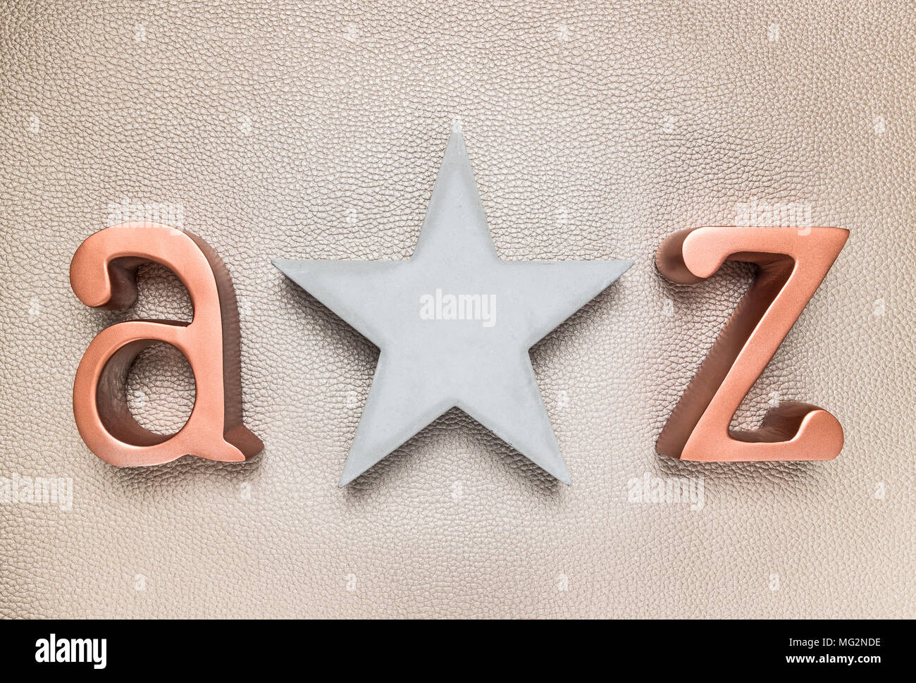 Concrete star and metal letters A and Z, on leather background. - Stock Image
