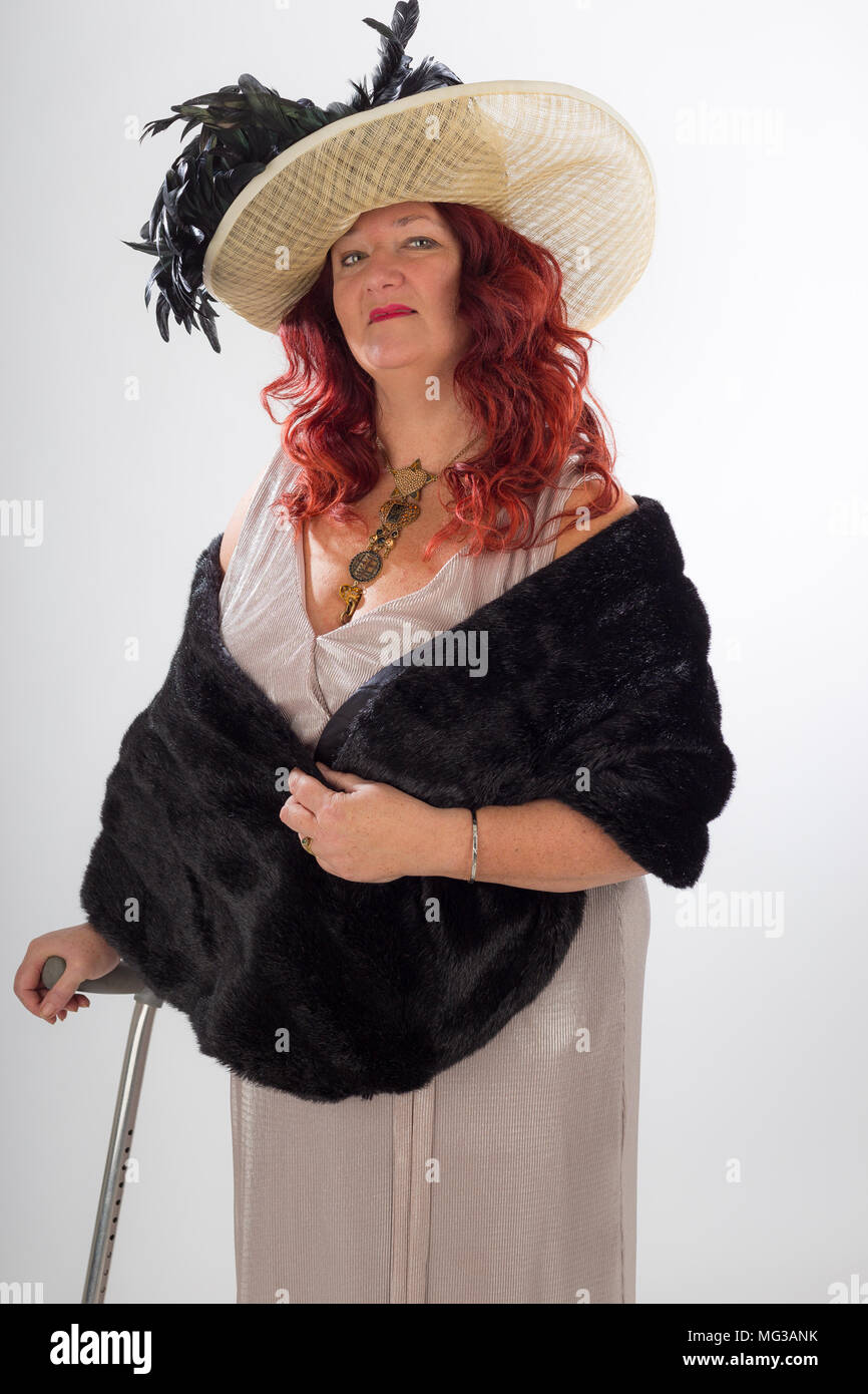 Fashionable vintage women with disability, clothing, posed, studio - Stock Image