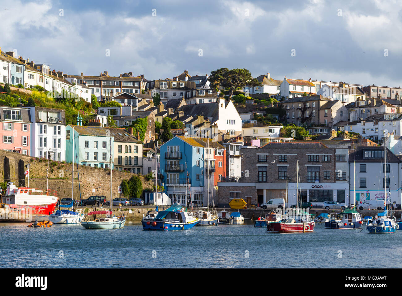 Brixham Harbour, seaside, with boats and colourful buildings, UK, England - Stock Image