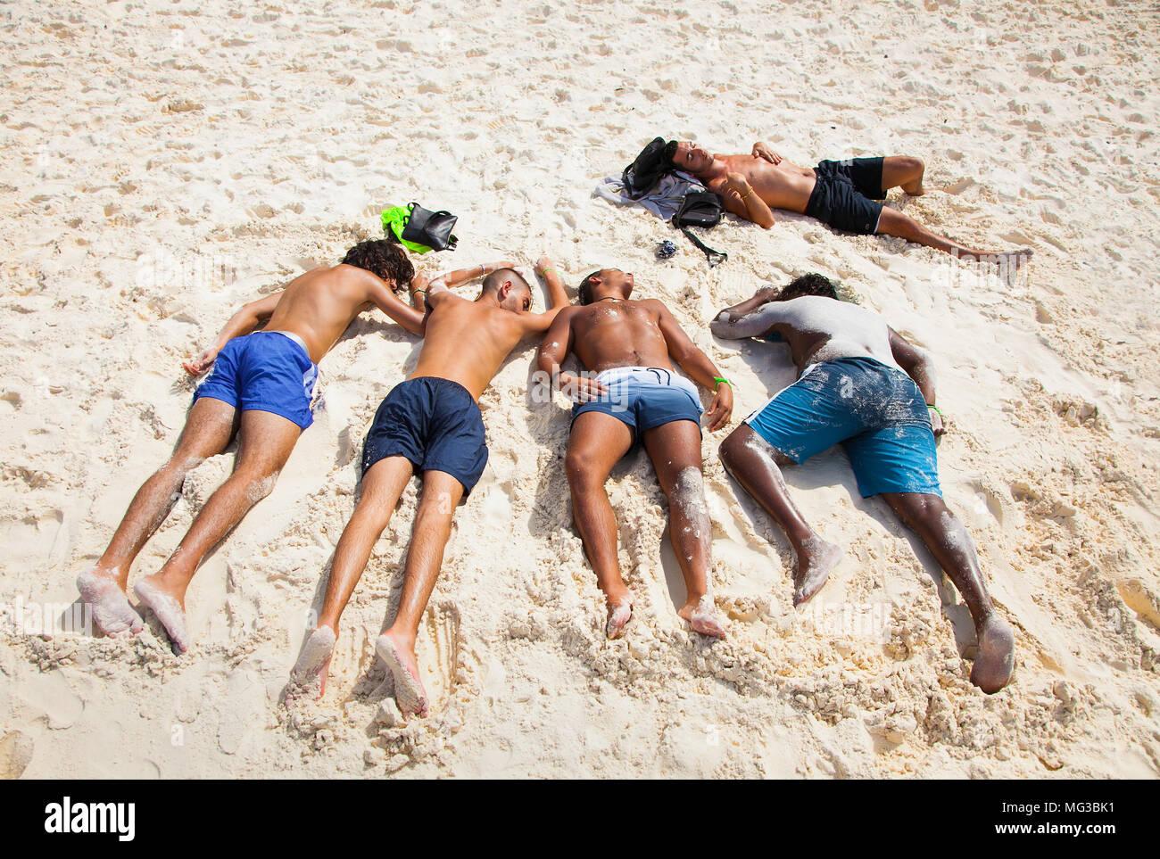 PHUKET, THAILND. JAN 25, 2016: Sleeping after full moon party on  Koh Mang beach on Jan 25, 2016, Thailand. - Stock Image
