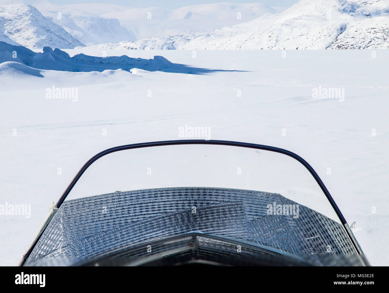 View of the fjord ahead from the front of a ski doo.  Nunavut, Baffin Island, Canada, arctic - Stock Image