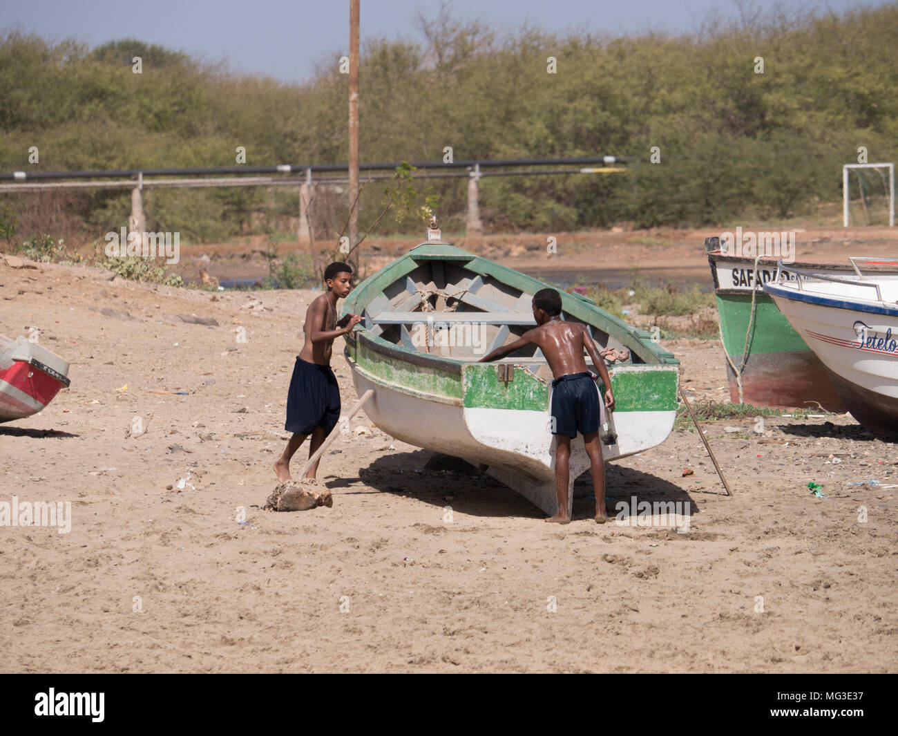 Boys with a boat on the island of Sal Cape Verde Stock Photo