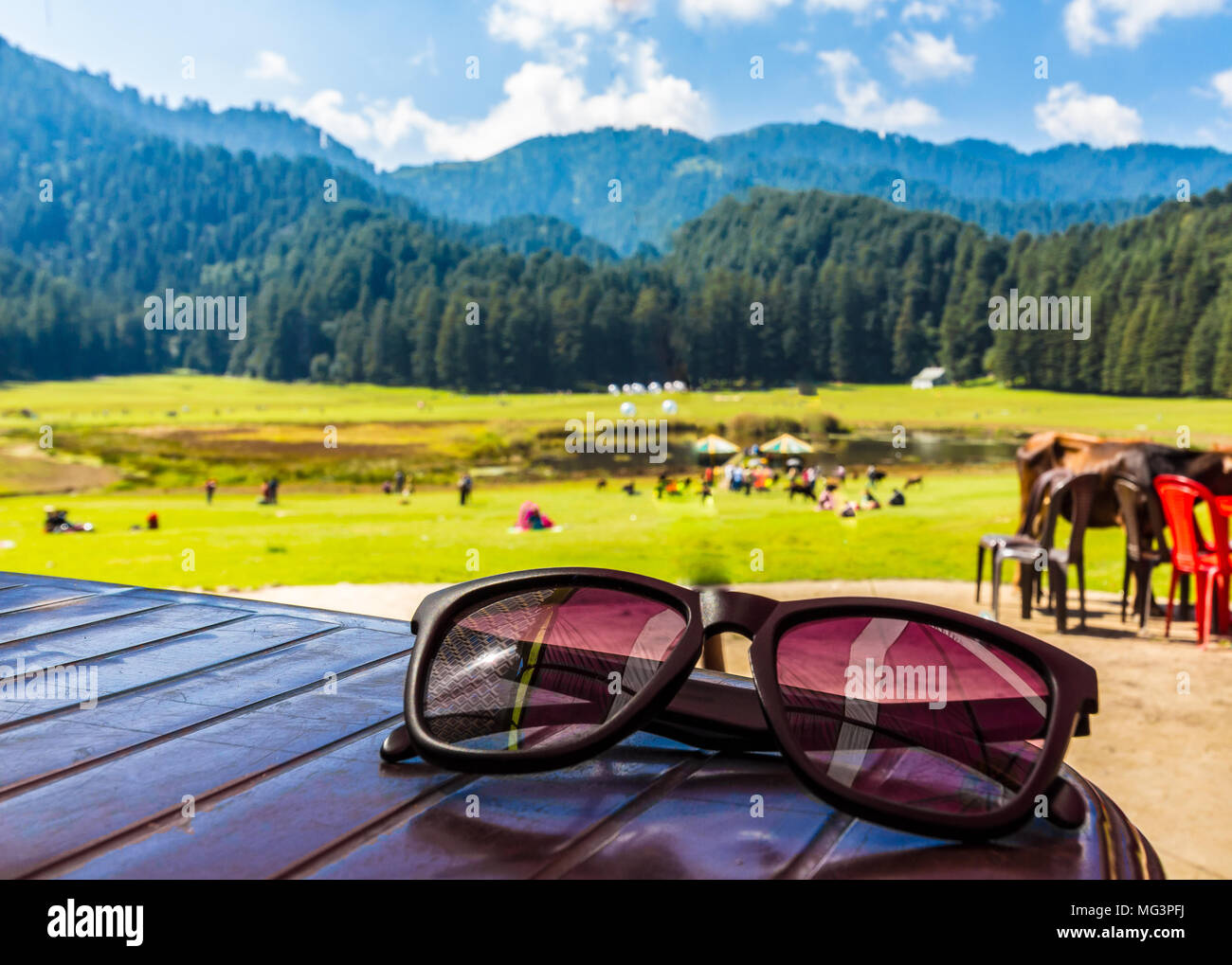 Cool shades and mountains in the background offering a majestic picturesque view of Khajjiar, Dalhousie, Himachal Pradesh, India. - Stock Image