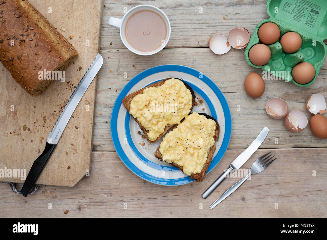 Scrambled eggs on two pieces of toast - Stock Image