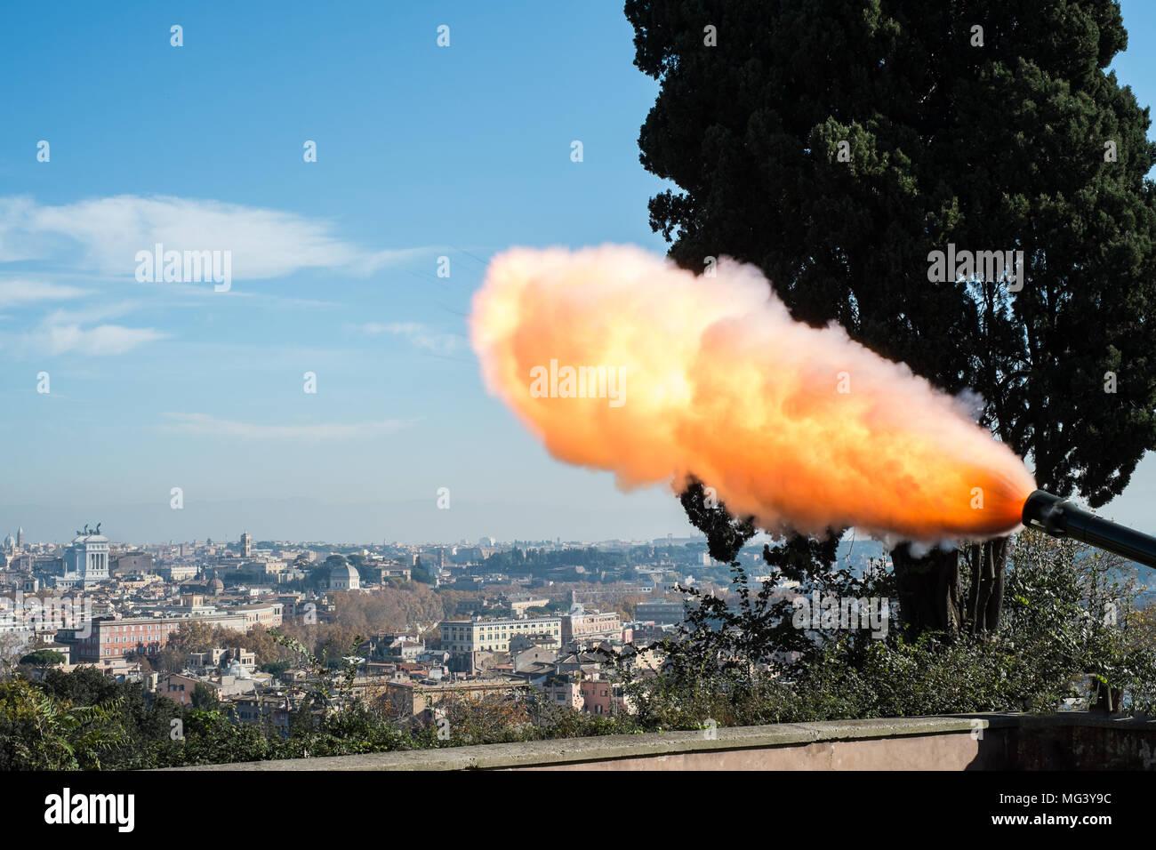 The twelve o'clock ritual gun fire in Rome from Gianicolo hill. - Stock Image