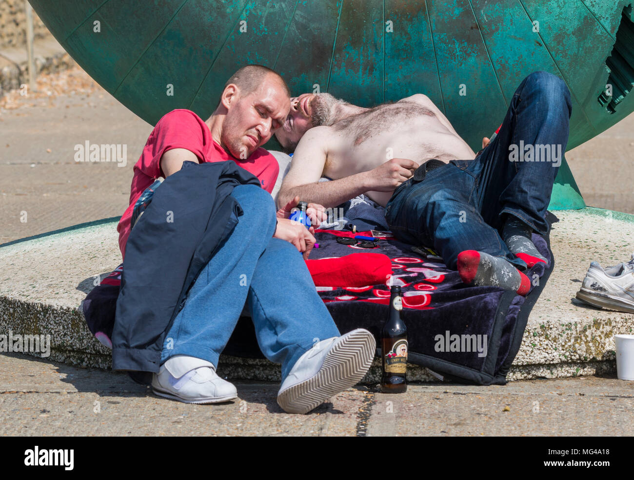Men appearing to be homeless and sleeping rough in Brighton, East Sussex, England, UK. Homelessness UK. - Stock Image