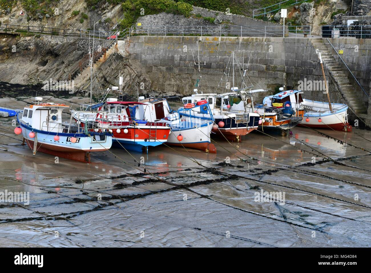 Fishing boats at low tide in Newquay harbour - Stock Image