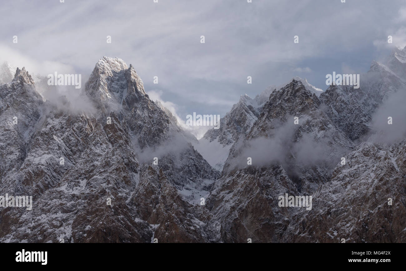 Passu Cathedral mountain peak with cloudy and foggy environment in Pakistan - Stock Image