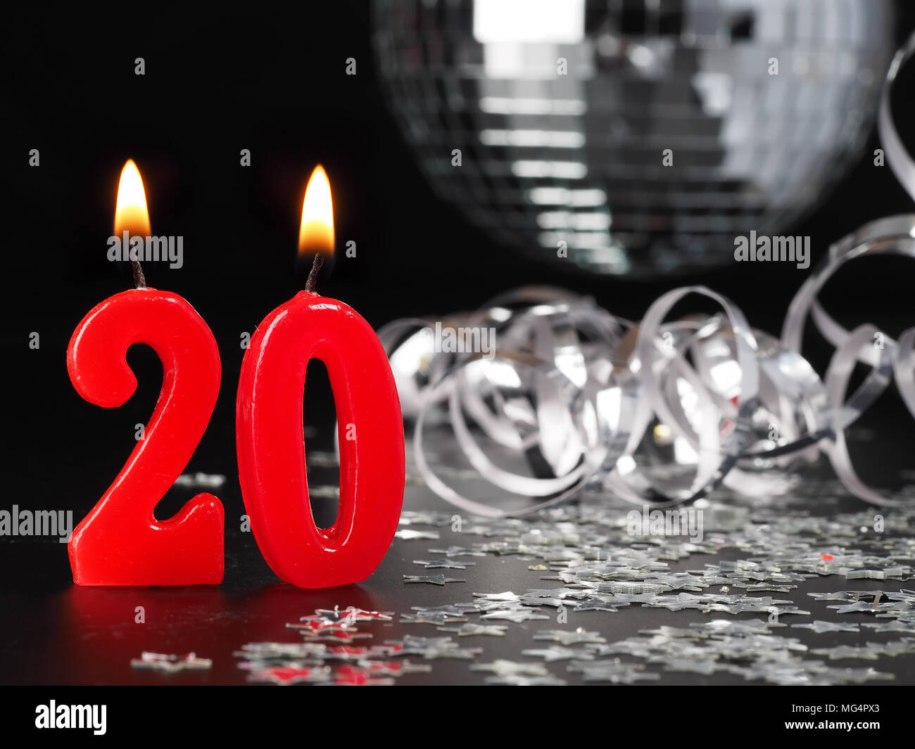 Red candles showing Nr. 20  Abstract Background for birthday or anniversary party. - Stock Image