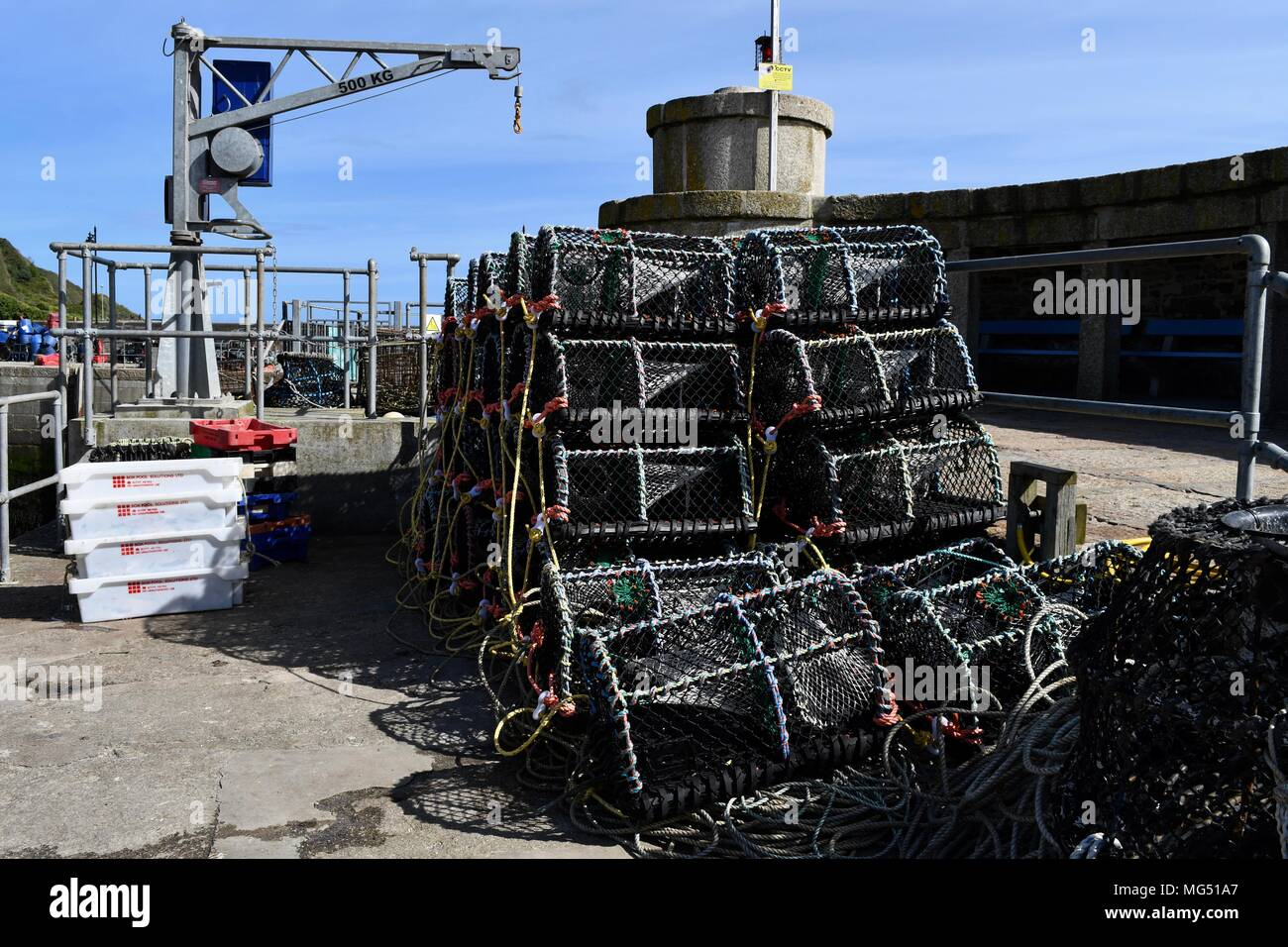 Lobster cages piled up in Newquay harbour - Stock Image