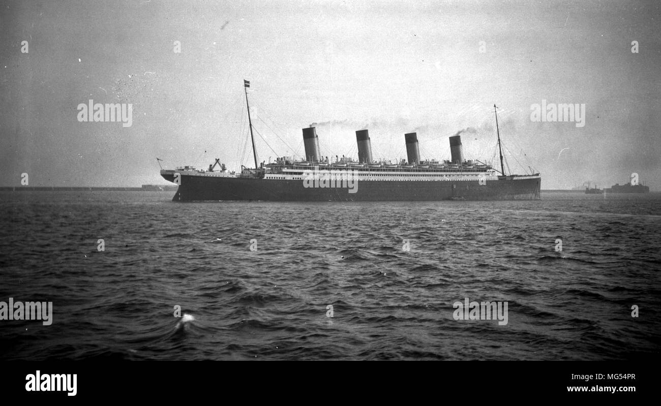 The White Star Line ocean liner RMS Olympic sailing off the coast of Cherbourg around 1912 after its refit increasing the number of lifeboats. - Stock Image