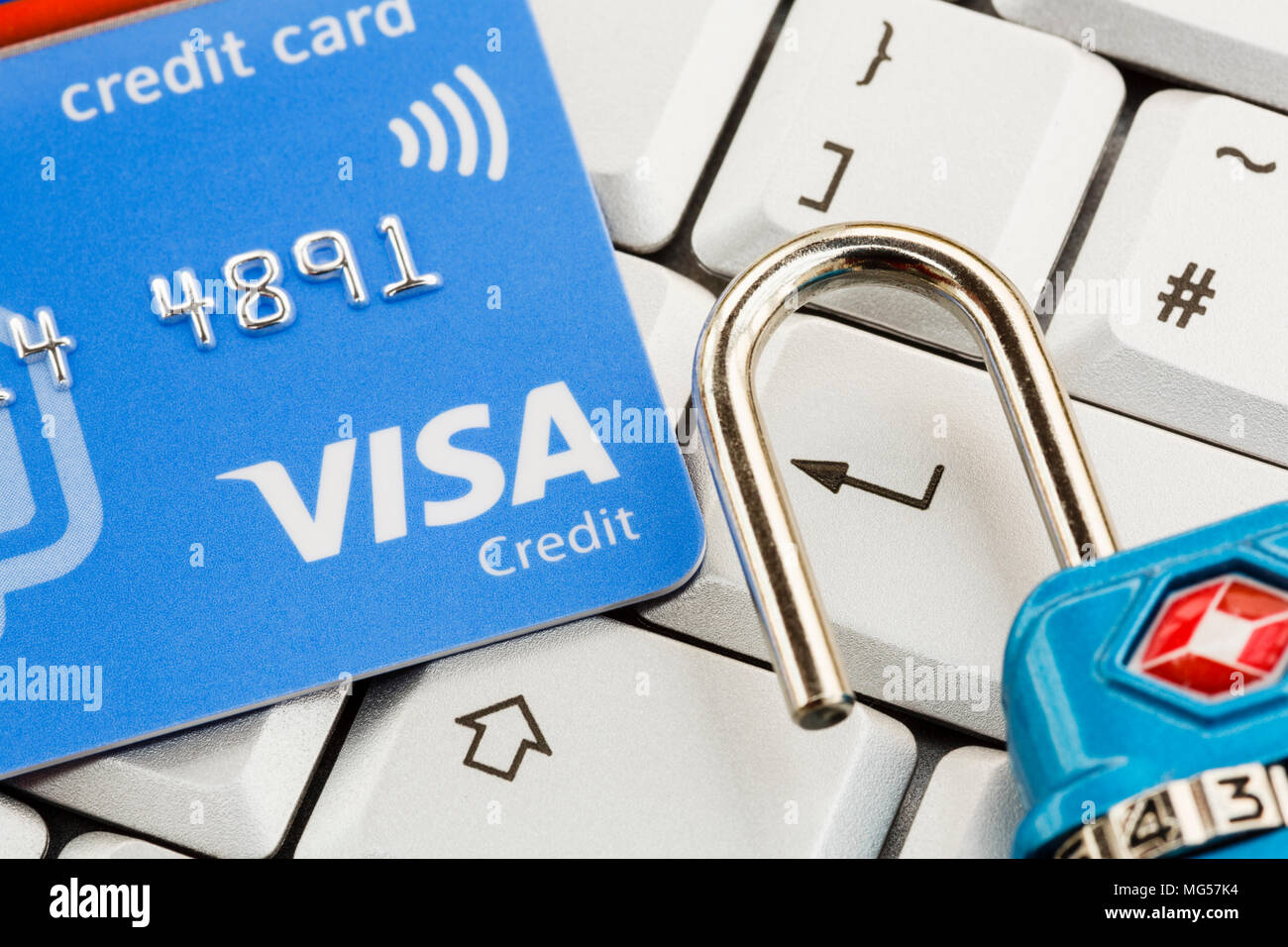 Visa contactless credit card on a keyboard with enter key and open padlock. Online shopping internet cyber security concept. England UK Britain Stock Photo