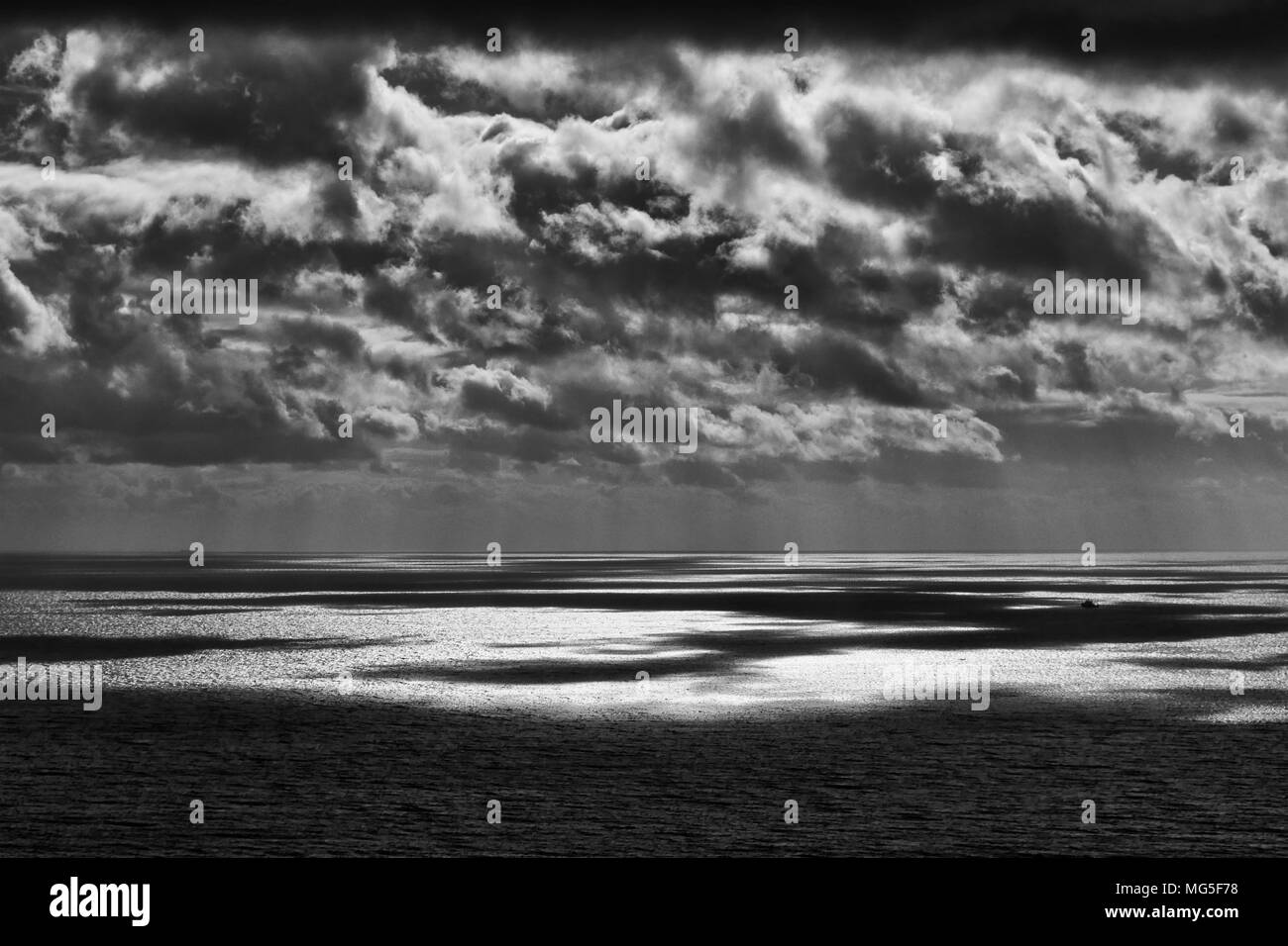 A simple seascape in black and white taken off the Dorset coast. - Stock Image