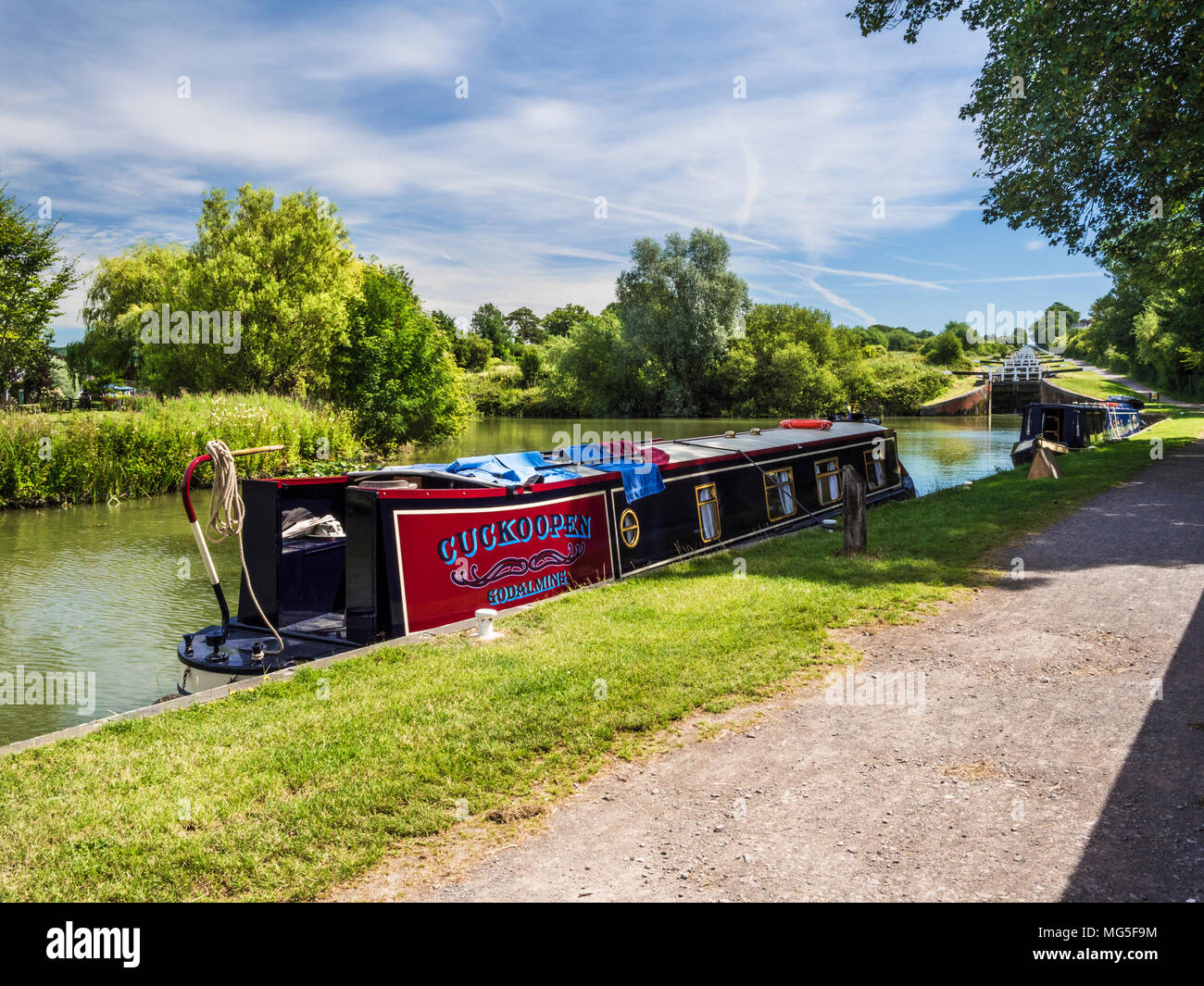 Houseboats moored on the Kennet and Avon Canal near the famous flight of locks at Caen Hill  in Wiltshire. - Stock Image