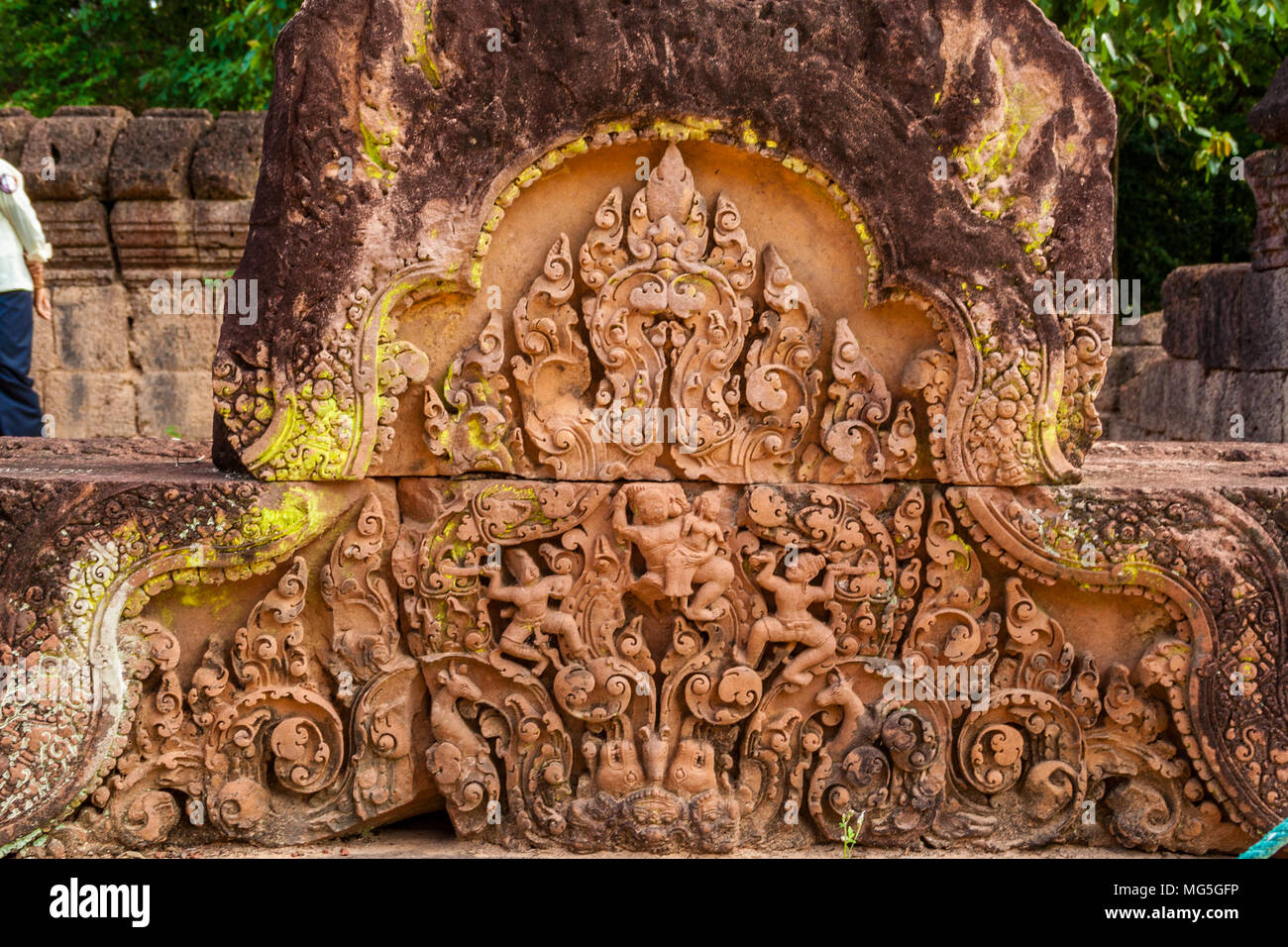 At the causeway of the outer enclosure of Cambodia's Banteay Srei (Citadel of the Women) temple stands this intricate bas-relief. - Stock Image