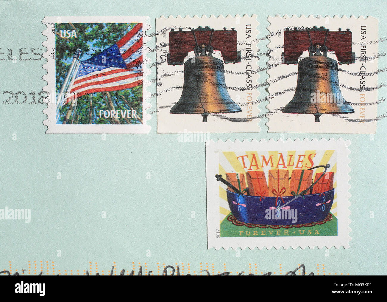 American stamps on envelope for international post to England, UK - Stock Image