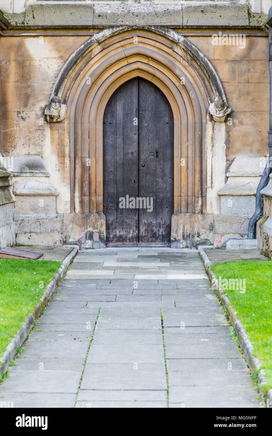 London, United Kingdom - April 9, 2015: A small wooden door on the side of Westminster ABbey in Central London - Stock Image
