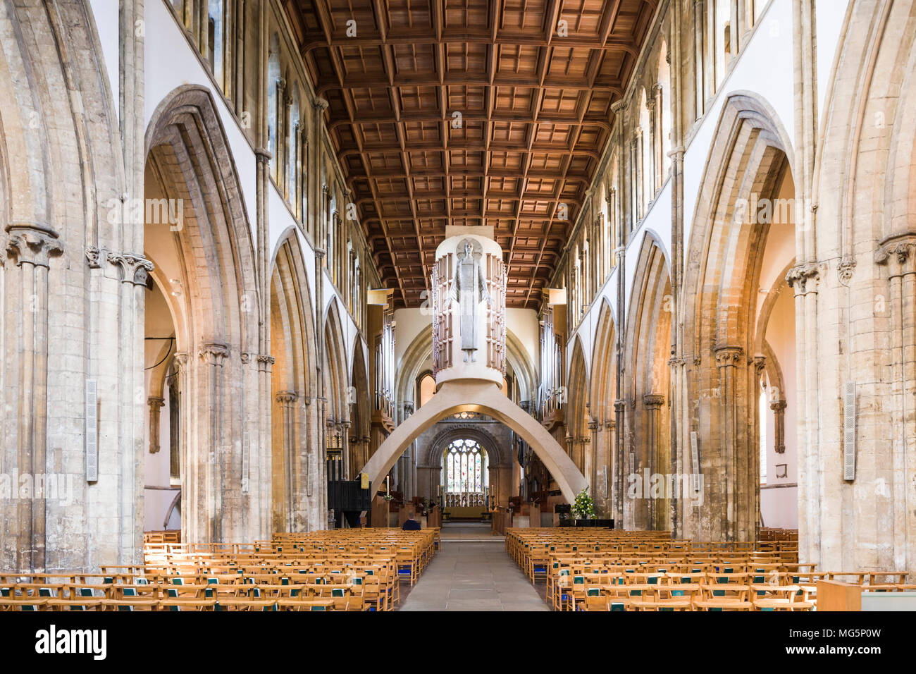 The nave of Llandaff Cathedral / Eglwys Gadeiriol Llandaf, Cardiff, a medieval church restored after WWII by George Pace; sculpture by Jacob Epstein. - Stock Image