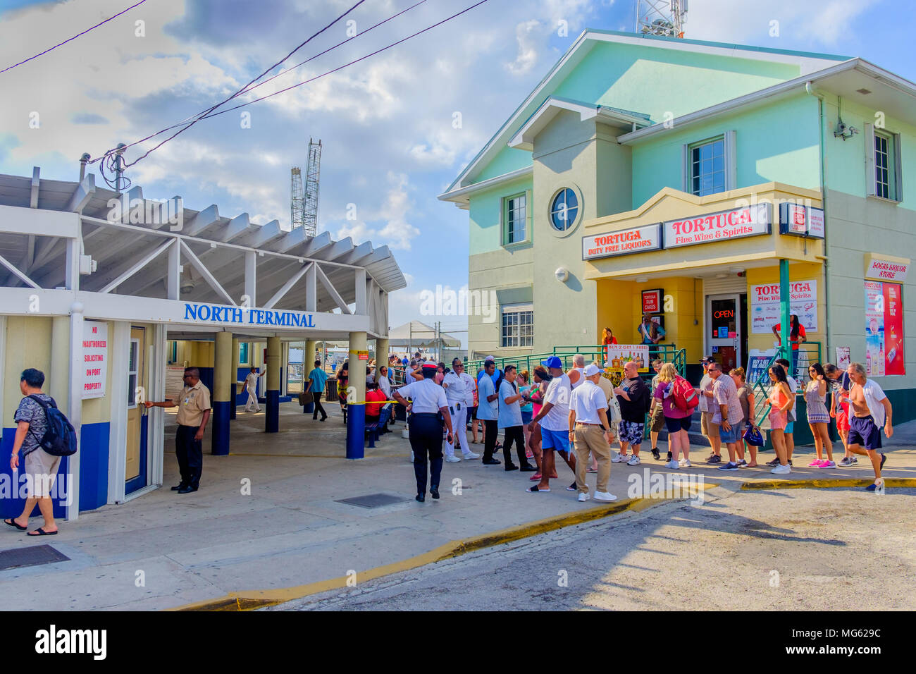 George Town, Grand Cayman, Cayman Islands, Feb 2018, tourists by the port North terminal queuing to re-embark on their cruise ship - Stock Image