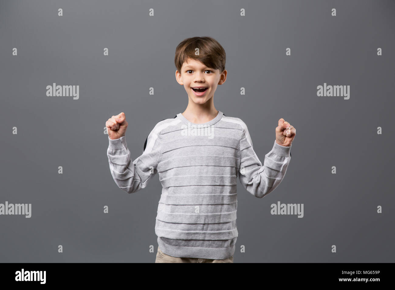 Pleasant joyful boy expressing his happiness - Stock Image