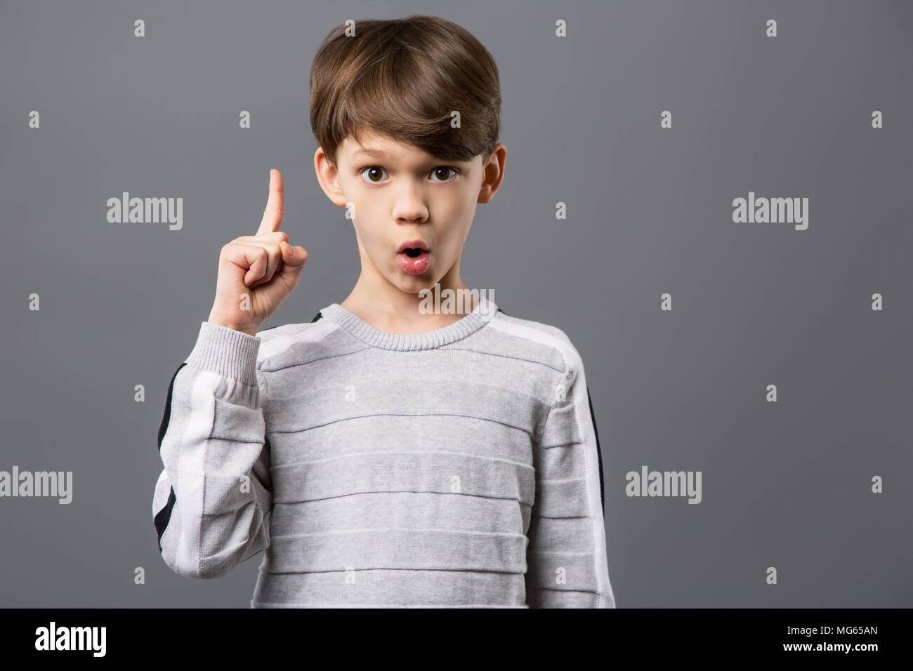 Delighted smart boy looking at you - Stock Image